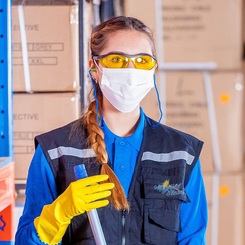 worker in industrial cleaning with protective gear