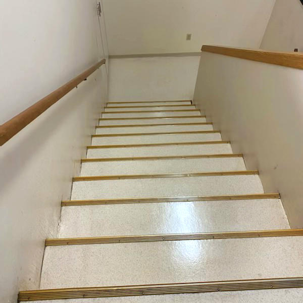 stripped and re-waxed linoleum stairs